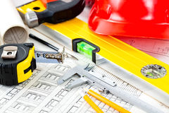 Construction drafts. And tools on the table Royalty Free Stock Photos