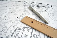 Construction drawing. A pen and ruler on a construction drawing Stock Photography