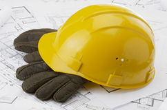 Construction drawing. A yellow hard hat over a construction drawing Stock Photo