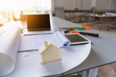 Construction drawing and house model on table workshop.  stock image