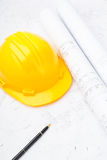 Construction drawing and safety helmet Stock Image