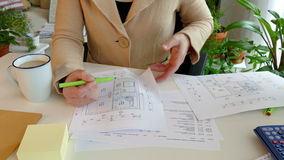 Construction drawing. A woman explain the construction drawing of a residential building stock video