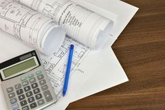 Construction drawings, calculator and pen Stock Photo