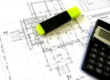 Construction drawings, felt-tip pen and calculator Royalty Free Stock Photo