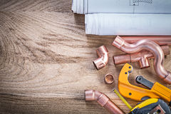 Construction drawings measuring tape water pipe cutter connector Royalty Free Stock Image