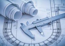 Construction drawings metal caliper on blueprint Royalty Free Stock Photos