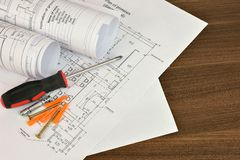 Construction drawings, screwdriver and screws Stock Photography