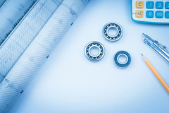 Construction drawings slide caliper roller bearings on blueprint architecture and building concept. Stock Image