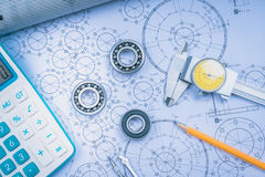 Construction drawings slide caliper roller bearings on blueprint architecture and building concept. Royalty Free Stock Image