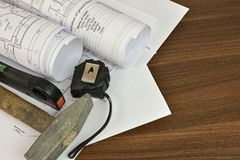 Construction drawings, tape, hammer and level Royalty Free Stock Photo