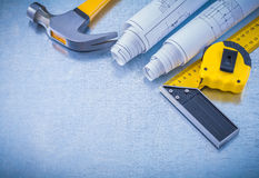 Construction drawings tape measure square ruler Royalty Free Stock Image