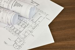 Construction drawings on a wooden surface Royalty Free Stock Images