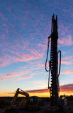 Construction Drill Dawn. Construction large drill standing tall with a dawn sky Royalty Free Stock Photo