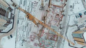 Construction of a house, aerial, copter shoot. Construction of a dwelling house in winter, high-altitude work, work of a construction crew, work of a crane stock footage