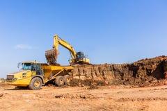 Construction Earthworks Excavator Grader Trucks royalty free stock images