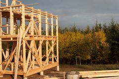 Construction of ecological house. Wooden frame of house under construction.Framed New Construction of a House. Royalty Free Stock Images