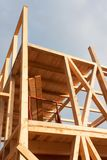 Construction of ecological house. Wooden frame of house under construction.Framed New Construction of a House. Stock Photography