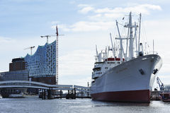 Construction of the Elbe Philharmonic and cargo ship MS Cap San Royalty Free Stock Photography