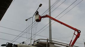 Construction Electrician Working Lamp Pole stock footage