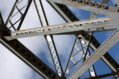 Construction element of the bridge. Detail of steel bridge construction over sky Stock Photography