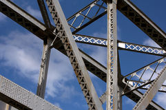 Construction element of the bridge. Detail of steel bridge construction over sky Stock Image