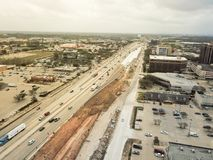 Construction of elevated highway in progress in Houston, Texas,. Aerial view construction of elevated highway in progress in Houston, Texas, USA. Workers and Stock Photography