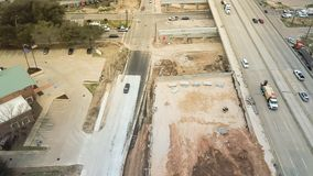Construction of elevated highway in progress in Houston, Texas,. Aerial view construction of elevated highway in progress in Houston, Texas, USA. Workers and Royalty Free Stock Image