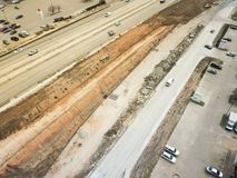Construction of elevated highway in progress in Houston, Texas,. Aerial view construction of elevated highway in progress in Houston, Texas, USA. Workers and Stock Photo