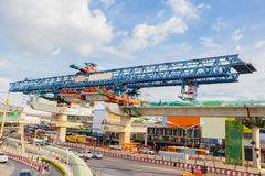Construction of an elevated train. Construction of an elevated commuter train Royalty Free Stock Images