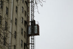 Construction elevator. An elevator installed on outside of building thats being renovated Royalty Free Stock Photography
