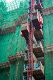 Construction with elevator lifts. Construction of cantilever floor with elevator lifts stock images