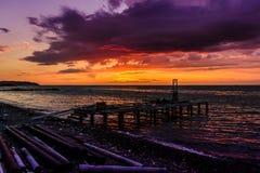 Construction empilée de café de dock dans le coucher du soleil Photo libre de droits