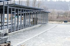 Construction of enclosures for a shelter for dogs. The theme of charity and mercy, animal shelter, dog rescue, volunteer work stock image