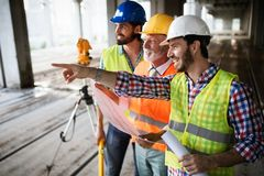 Construction engineer with foreman worker checking construction site royalty free stock images