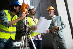 Construction engineer with foreman worker checking construction site. Construction engineer architect with foreman worker checking construction site stock photos