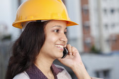 Construction engineer with cellphone Stock Images