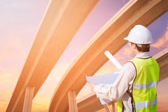 Construction engineer checking construction drawing stock photos