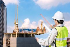 Construction engineer checking construction drawing royalty free stock photography