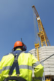 Construction engineer and crane Royalty Free Stock Photo