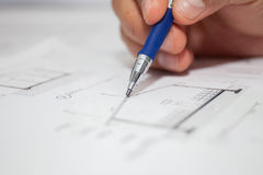 Construction engineer draws pencil Stock Photography