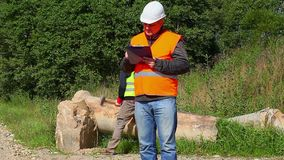 Construction Engineer with folder and worker stock video footage