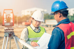 Construction engineer with foreman worker checking construction. Drawing for new Infrastructure project. photo concept for engineering work royalty free stock photos
