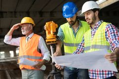 Construction engineer with foreman worker checking construction site. Construction engineer architect with foreman worker checking construction site royalty free stock photo