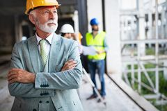 Construction engineer with foreman worker checking construction site. Construction engineer architect with foreman worker checking construction site stock images