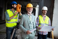 Construction engineer with foreman worker checking construction site stock images