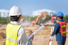 Construction engineer and foreman worker checking site. Construction engineer and foreman worker checking construction drawing at site for new Infrastructure royalty free stock images