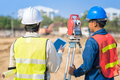 Construction engineer and foreman worker checking site. Construction engineer and foreman worker checking construction drawing at site for new Infrastructure stock photos