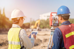Construction engineer and foreman worker checking site. Construction engineer and foreman worker checking construction drawing at site for new Infrastructure royalty free stock image