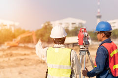 Construction engineer and foreman worker checking site. Construction engineer and foreman worker checking construction drawing at site for new Infrastructure stock images