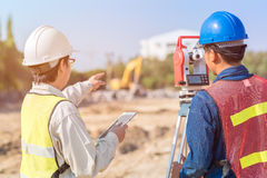 Construction engineer and foreman worker checking site. Construction engineer and foreman worker checking construction drawing at site for new Infrastructure stock photography